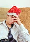 Sad Young Man in Santa Hat Stock Photo