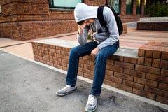 Sad Young Man. Sit on the City Street stock photos