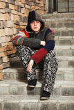 Sad young fashion man sitting on the steps Royalty Free Stock Photo