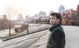 Sad young man standing on a city street. Sad teenager standing on city street stock photos