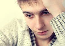 Sad Young Man. Toned Photo of Sad Young Man Portrait closeup Stock Photo