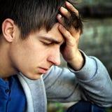 Sad Young Man. Toned Photo of Sad Young Man Portrait closeup Royalty Free Stock Photography