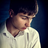Sad Young Man. Toned Photo of Sad Young Man Portrait on The Dark Background Stock Photos