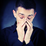 Sad Young Man. Toned Photo of Sorrowful Young Man on The Dark Background royalty free stock image