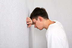 Sad Young Man. By the White Wall Stock Photography