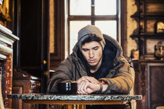 Sad young man in winter clothes Stock Photos