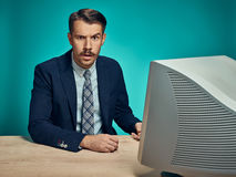 Sad Young Man Working On computer At Desk Royalty Free Stock Image