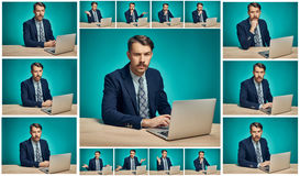 Sad Young Man Working On computer At Desk Royalty Free Stock Photography