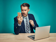 Sad Young Man Working On Laptop At Desk Royalty Free Stock Photo