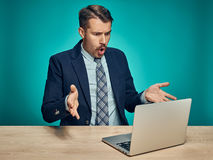 Sad Young Man Working On Laptop At Desk Stock Images