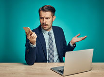 Sad Young Man Working On Laptop At Desk Stock Photos