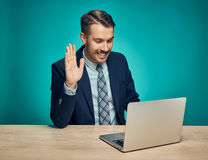 Sad Young Man Working On Laptop At Desk Royalty Free Stock Images