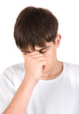 Sad Young Man. Sad and Worried Young Man Isolated on the White Background Stock Photo