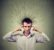 Sad young man with worried stressed face expression and brain melting into lines Royalty Free Stock Images