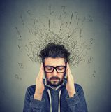 Sad young man with worried stressed face expression royalty free stock photo