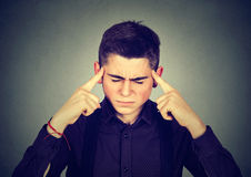 Sad young man with worried stressed face expression looking down royalty free stock photography