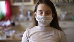 Epidemic, pandemic young girl stay at home under quarantine for self-isolation due to an infection with the china