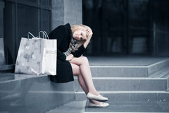 Sad young fashion woman with shopping bags at the mall Royalty Free Stock Photo