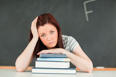 Sad young student receiving bad mark Stock Images