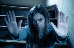 Sad young teen girl showing the hands in Stop Violence,abuse, and cyber bullying stock photos