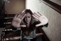 Sad young teen girl showing the hands in Stop Violence,abuse, and cyber bullying royalty free stock photography