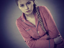 Sad young teenager woman on bed feeling pain Royalty Free Stock Photo