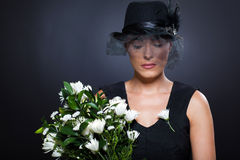 Widow with flowers Royalty Free Stock Photos