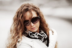 Sad young fashion woman with long curly hairs Stock Photo