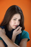 Sad Young Woman. Holds a scarf tightly near her face Royalty Free Stock Photo