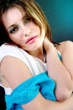 Sad Young Woman. Portrait of a woman with a sad expression, hugging herself, one arm of her dress has slid down her arm nearly to her elbow.  (Still wearing a Royalty Free Stock Photo