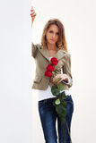 Sad young woman with a red roses Stock Photography