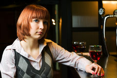 Sad young woman in a bar. Royalty Free Stock Photos