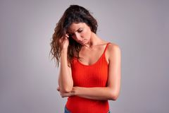 Sad young woman. A beautiful young woman wearing a red top and feeling sadr Royalty Free Stock Photos