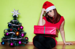 Sad young woman in Christmas time Royalty Free Stock Image
