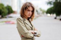 Sad young fashion woman on city street Stock Photography