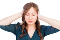 Sad young woman covering her ears Stock Photos