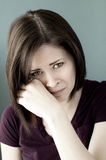 Sad young woman crying Stock Images