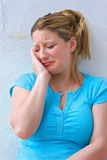Sad young woman crying alone. Royalty Free Stock Images