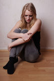 Sad young woman crying Royalty Free Stock Images