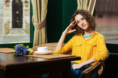 Sad young fashion woman drinking tea at restaurant Royalty Free Stock Photography