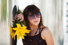 Sad young woman with a flowers Stock Photos