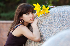 Sad young woman with a flowers Royalty Free Stock Photo