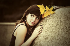 Sad young woman with a flowers outdoor Stock Image