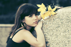 Sad young woman with a flowers outdoor Stock Photo