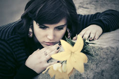 Sad young woman with a flowers outdoor Royalty Free Stock Photos