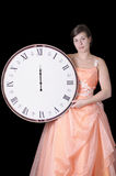 Sad young woman in gown holding a midnight clock Royalty Free Stock Images