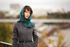 Sad young woman in grey classic coat Royalty Free Stock Images