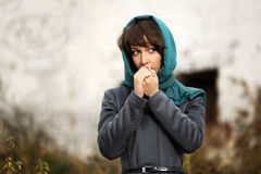 Sad young woman in grey classic coat Stock Photography