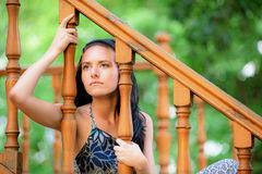 Sad young woman at handrail Stock Images