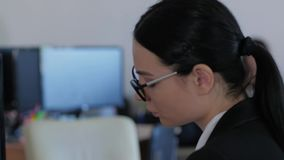 Sad young woman has no fun while working and thinks about something in office close-up stock video footage